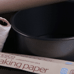 Silicon paper, brown paper and string for lining Christmas cake tin