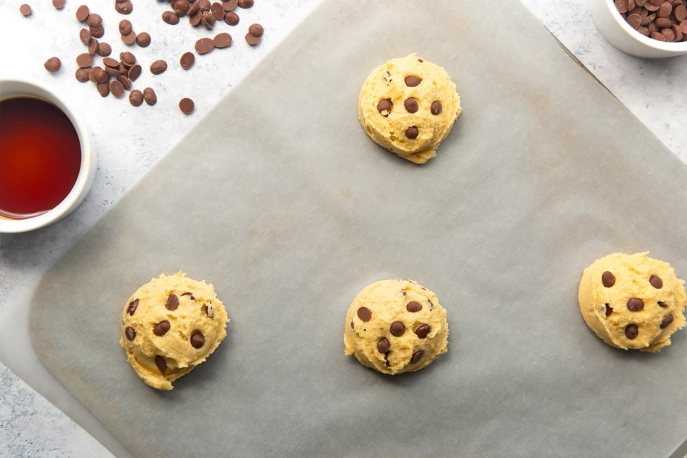 Additional chocolate chips added to each of the four dairy free chocolate chip cookies