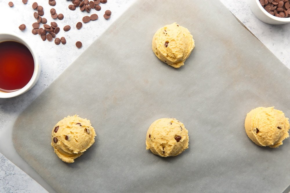 four balls of dairy free chocolate chip cookies dough