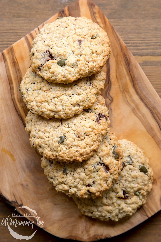 Vegan oat cookies arranged on a wooden board.