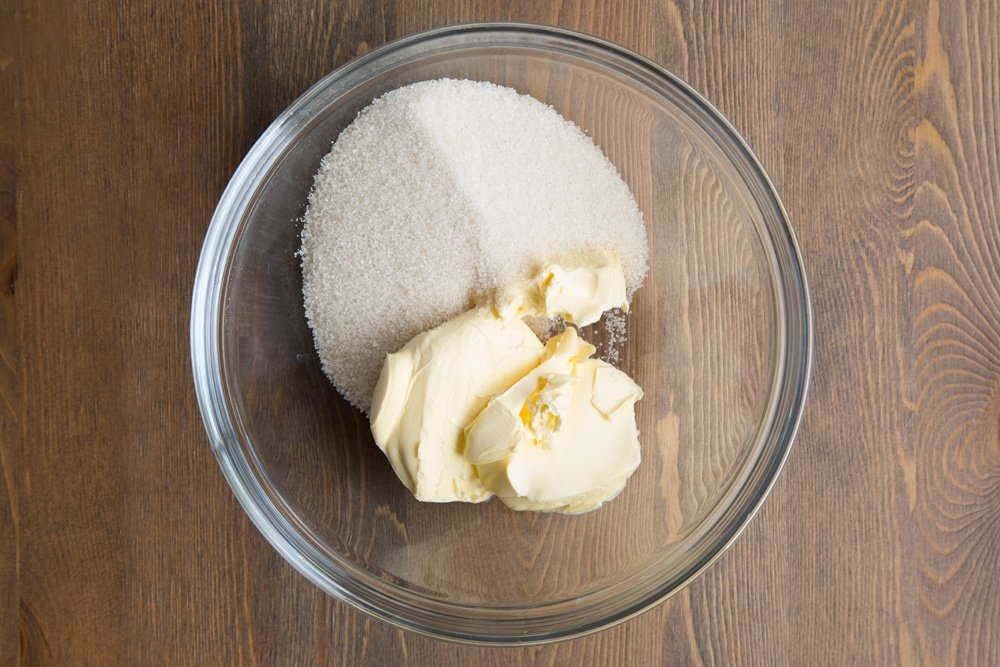 Butter and sugar in a bowl.