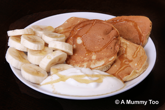 Easy to make, fluffy pancakes, server with a generous portion of fruit and yoghurt.