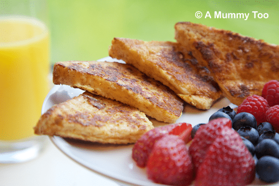 Deliciously decadent cinnamon toast, topped with fresh fruit.