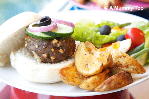 Lamb and feta burger with salad and wedges