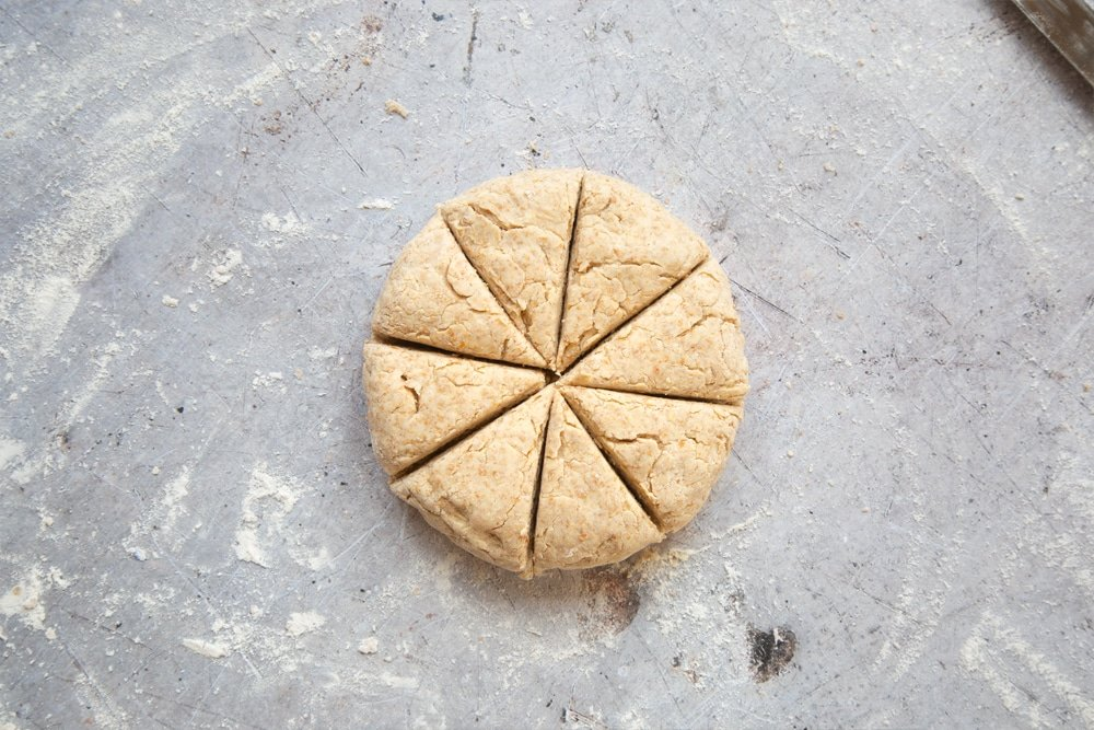 Scone dough cut into eight triangles