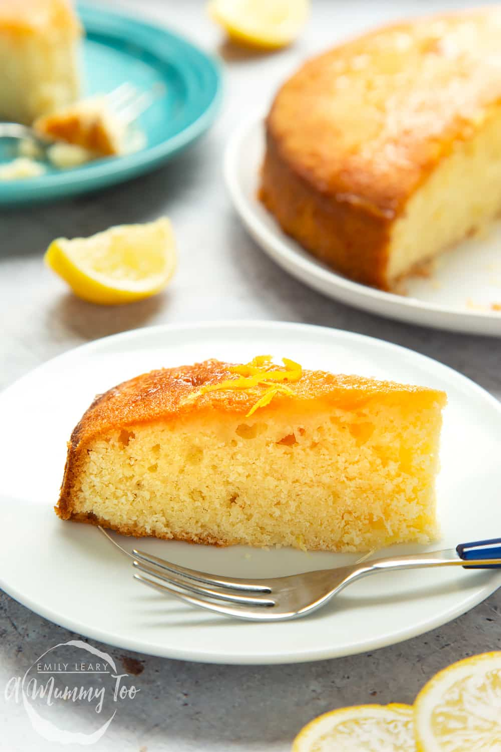 A slice of lemon drizzle cake served on a plate