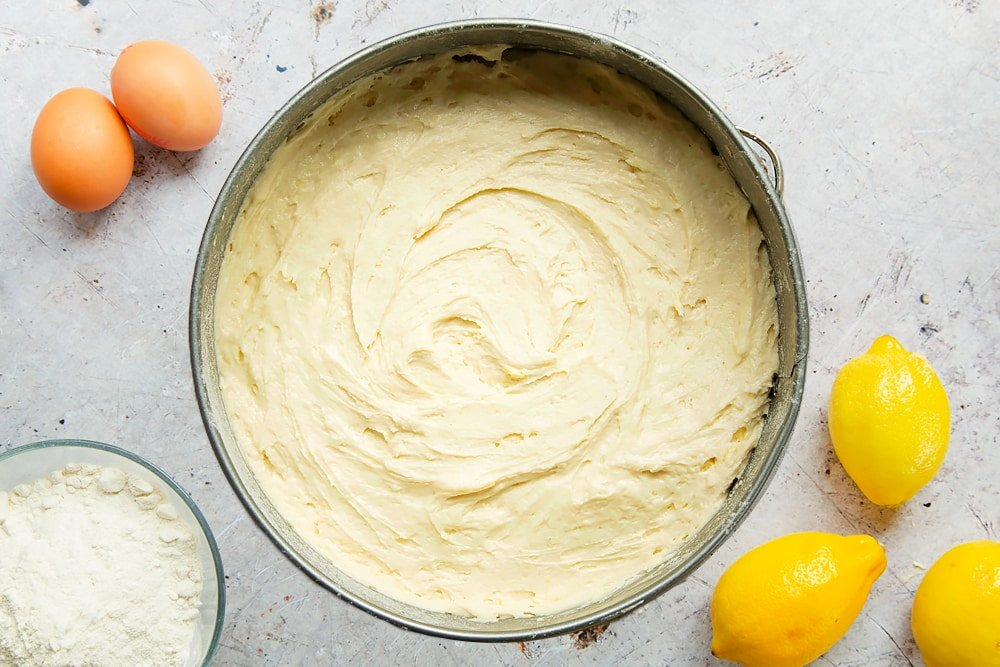 The lemon drizzle cake batter in a springform tin