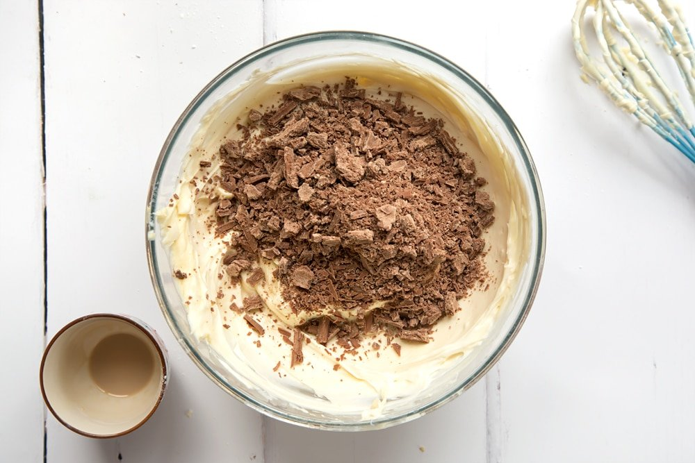 Cream, icing sugar, cream cheese and Baileys combined in a mixing bowl. Chocolate added.