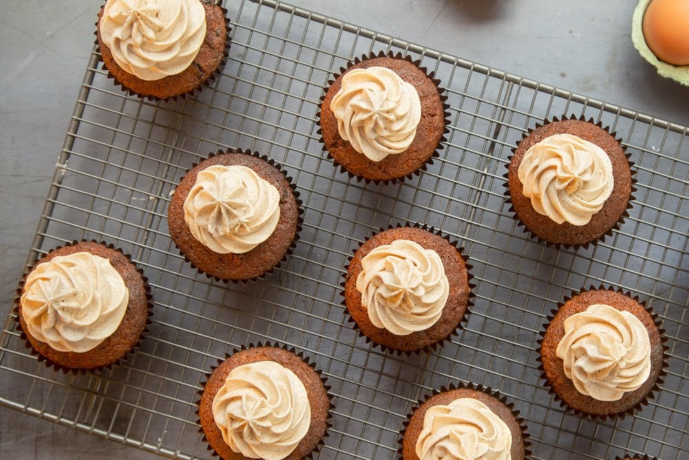 Christmas pudding muffins with piped spiced rum frosting