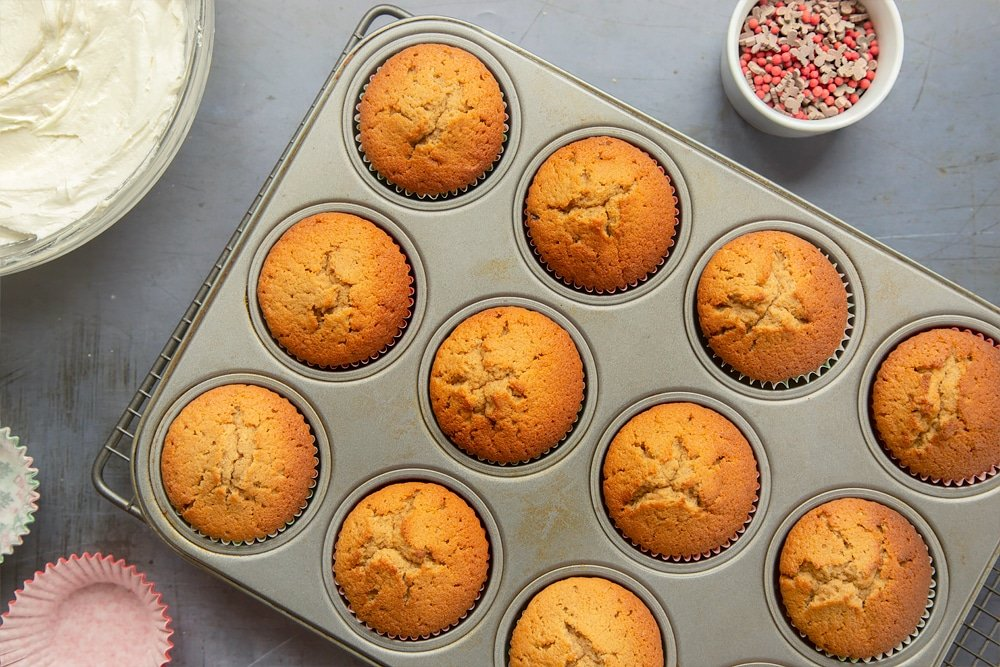 Overhead shot of the spiced Christmas cupcakes after being baked in the oven for 18 minutes.