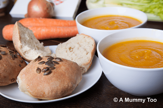 Butternut squash slow cooked soup with crusty thyme and pumpkin seed rolls
