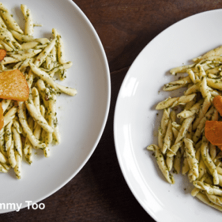 Fresh strozzapreti pesto pasta with roast sweet potato and butternut squash