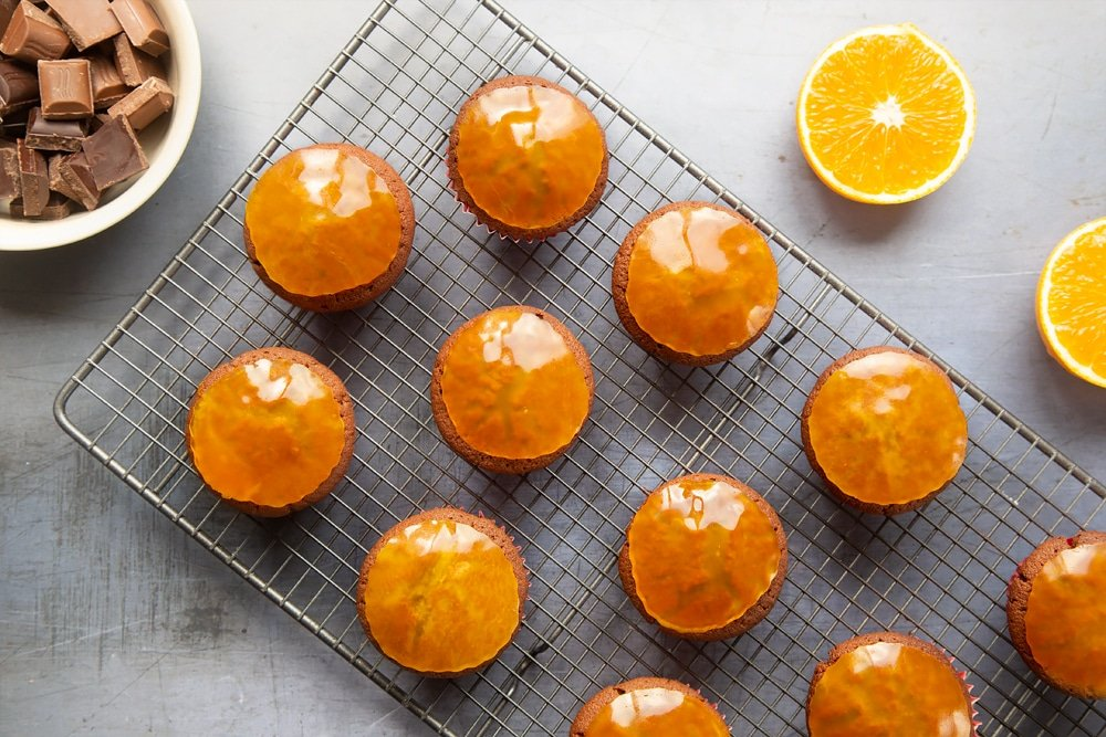 Top the cupcakes with a round of orange jelly