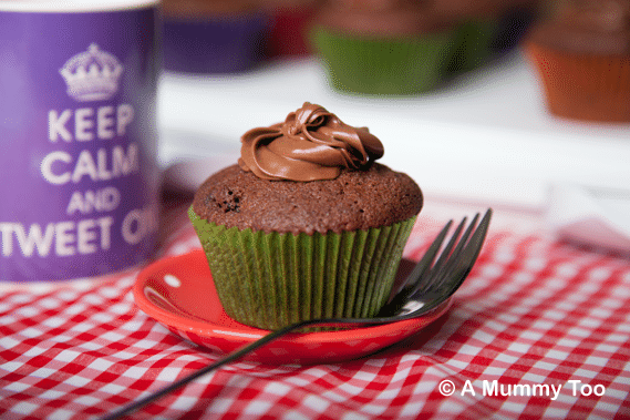 Chocolate chip raisin muffins with hazelnut cocoa frosting