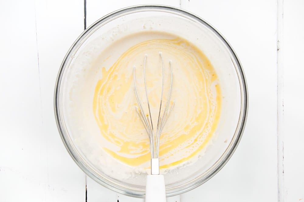 Mixing margarine into the vegan pancake mix