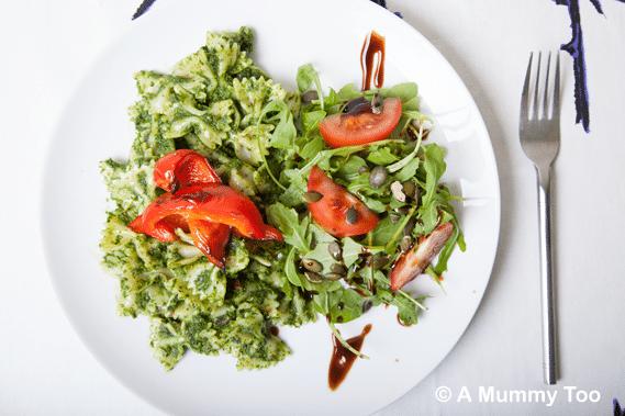 Kale pesto pasta served with a rocket salad