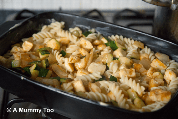 Add the drained pasta and vegetable mix to a baking dish