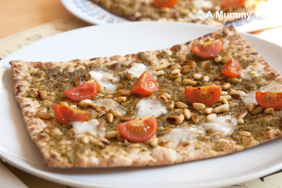Pesto-pizza-with-toasted-pine-nuts,-goats-cheese-&-cherry-tomatoes