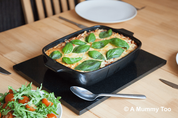 Freshly baked smokey halloumi pasta bake served to a table