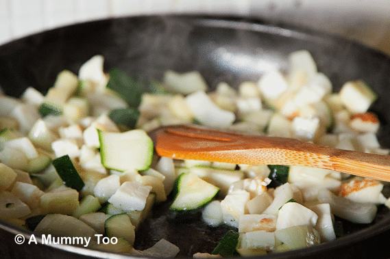 Frying vegetables and halloumi in a pan