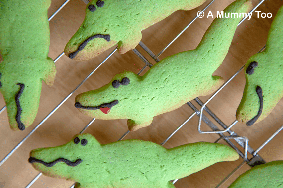 Fun crocodile sugar cookies on a cooling rack