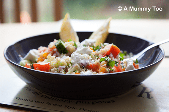 Herbed bulgur wheat with crunchy pepper and goat's cheese served in a bowl