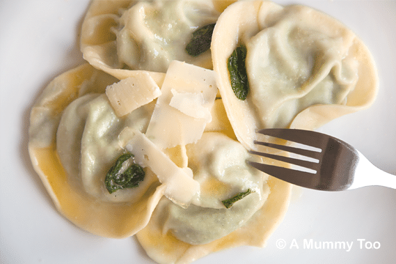 Spinach and ricotta ravioli in lemon and sage butter topped with cheese