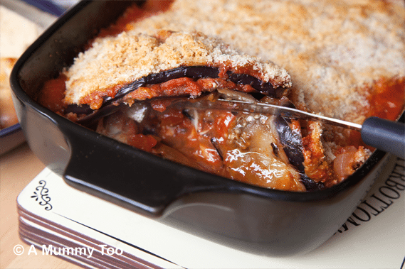 Serving-Aubergine,-tomato-and-mozzarella-bake