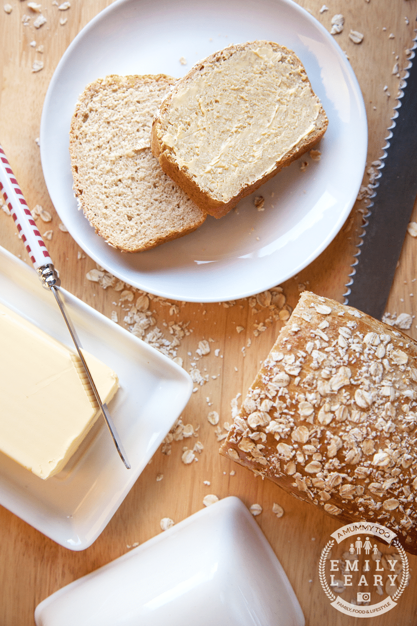 Deliciously light honey and oat bread, shown sliced and served with butter