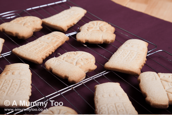 Dalek and Sontaran cinnamon cookies on a cooling rack