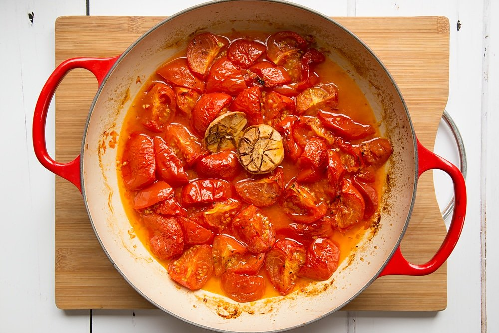 Roasted tomatoes and garlic in a pan