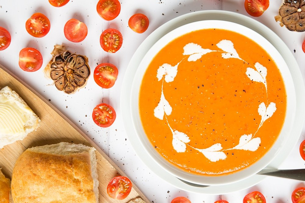 Serve your roasted tomato and garlic soup with creme fraiche and crusty bread