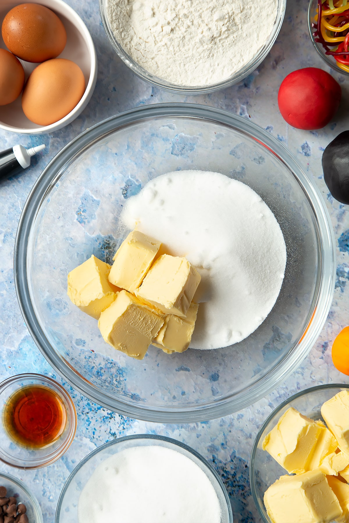 Butter and sugar being mixed in a bowl for the snowman cupcakes.