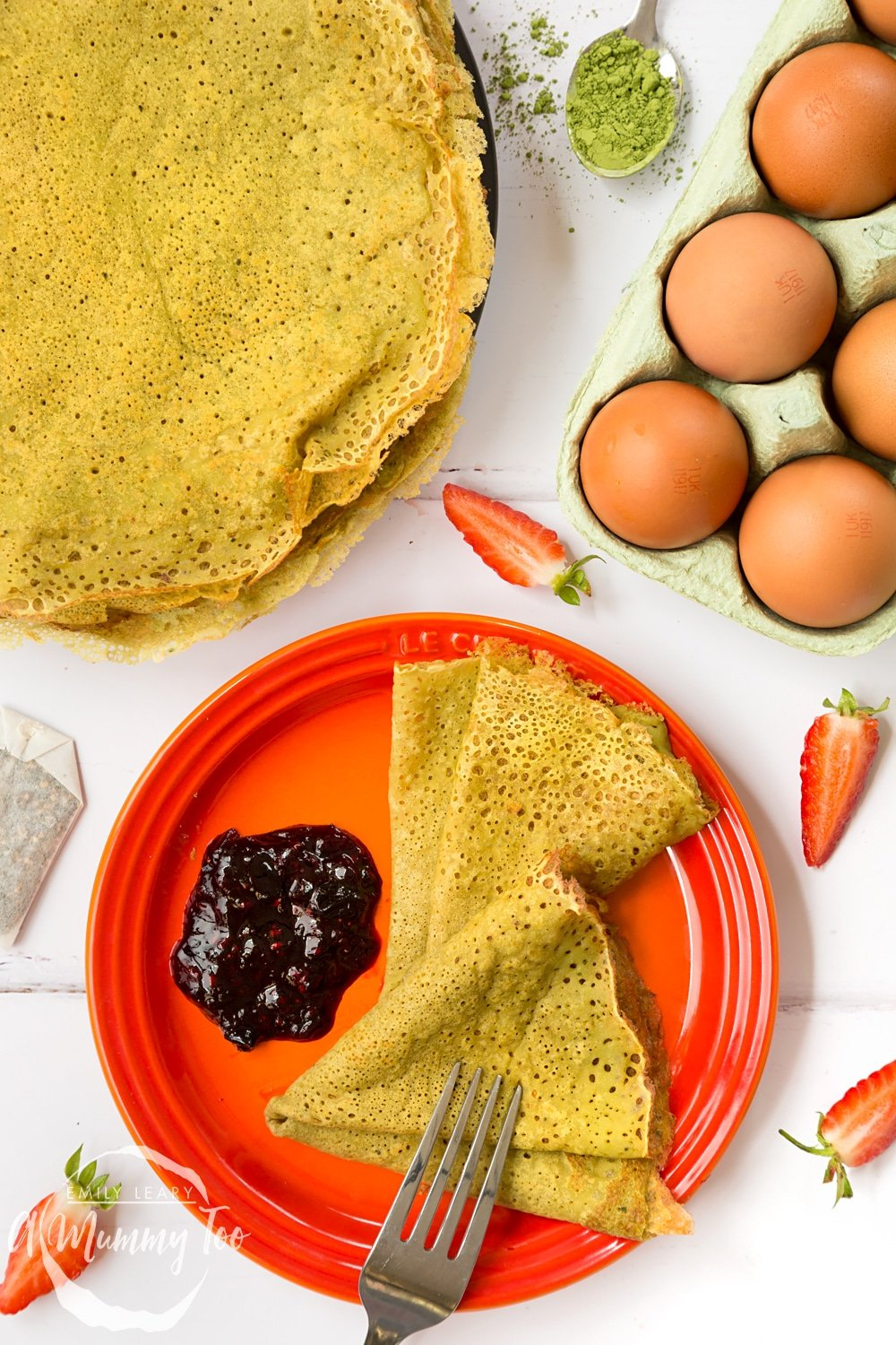 Delicate matcha pancakes, flavoured with matcha tea and served with a homemade berry sauce