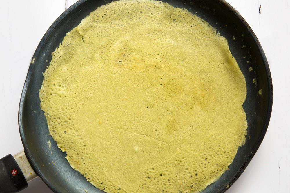 Flipped crepe, cooking in a frying pan