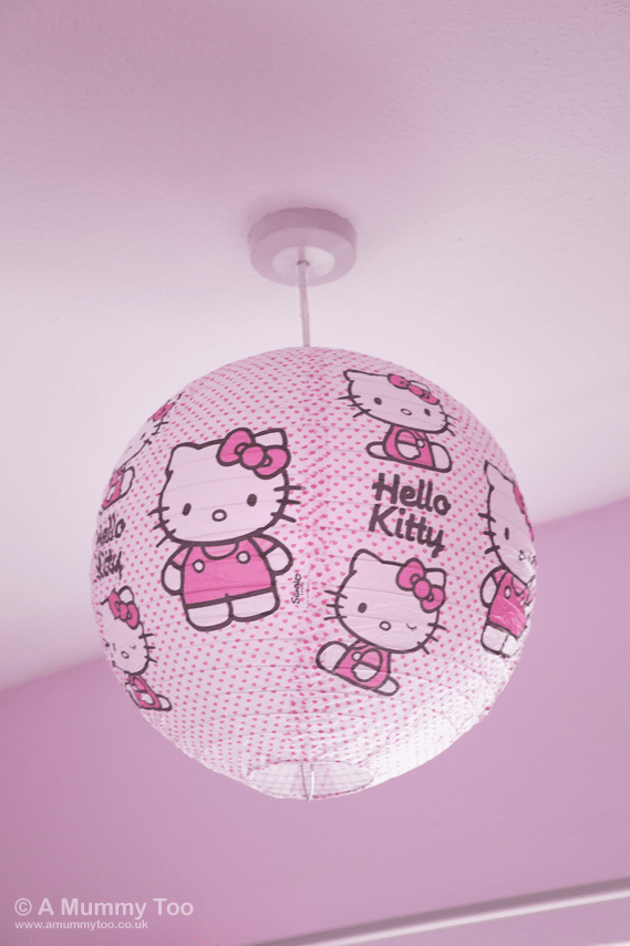Hello Kitty 'Hearts' Paper Shade  hangs from the ceiling and catches the light throughout the day.