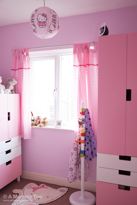 This pink, newly decorated children's bedroom is immediately bright and inviting