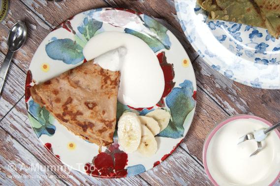 Cranberry and apple pancakes with fruity crème fraîche