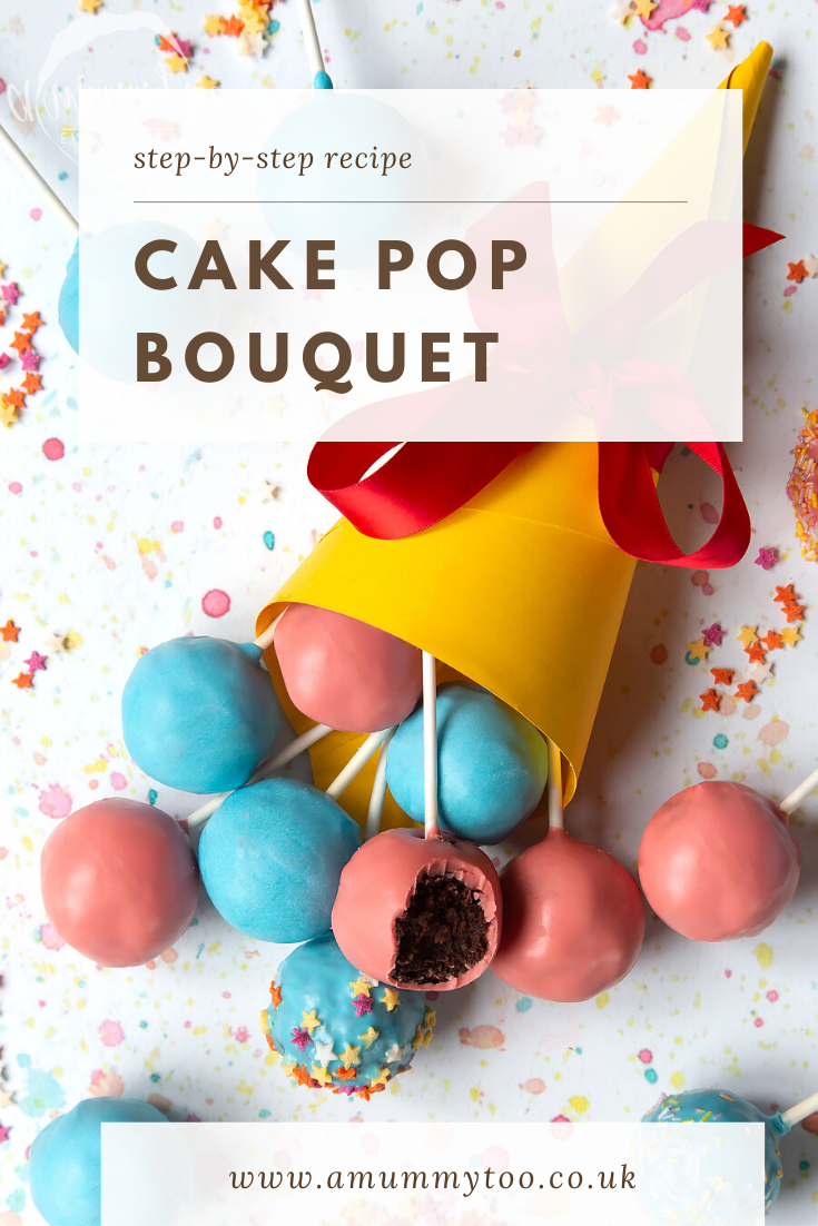 A cake pop bouquet surrounded by other cake pops. The bouquet is made from several blue and pink cake pops, gathered together and wrapped in a yellow paper cone with a red ribbon. One of the cake pops has a bite taken out of it, showing the chocolate sponge filling inside. Caption reads: step-by-step recipe cake pop bouquet