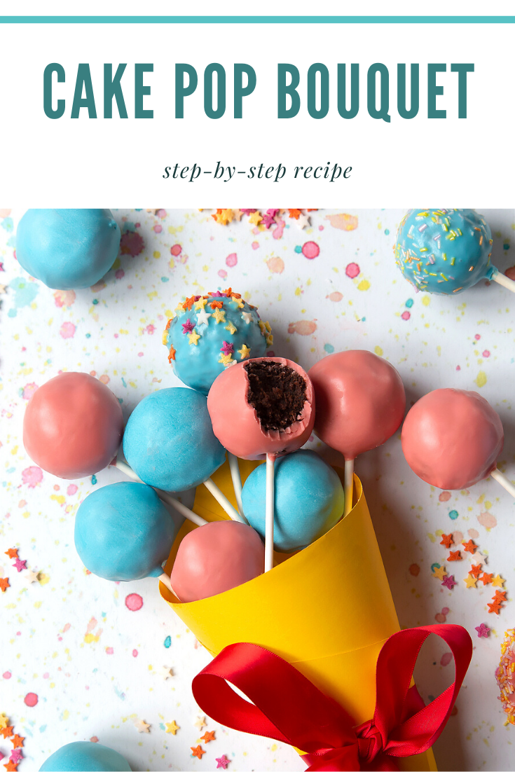 A cake pop bouquet surrounded by other cake pops. The bouquet is made from several blue and pink cake pops, gathered together and wrapped in a yellow paper cone with a red ribbon. One of the cake pops has a bite taken out of it, showing the chocolate sponge filling inside. Caption reads: cake pop bouquet step-by-step recipe