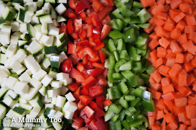Chopped vegetables including peppers and courgette