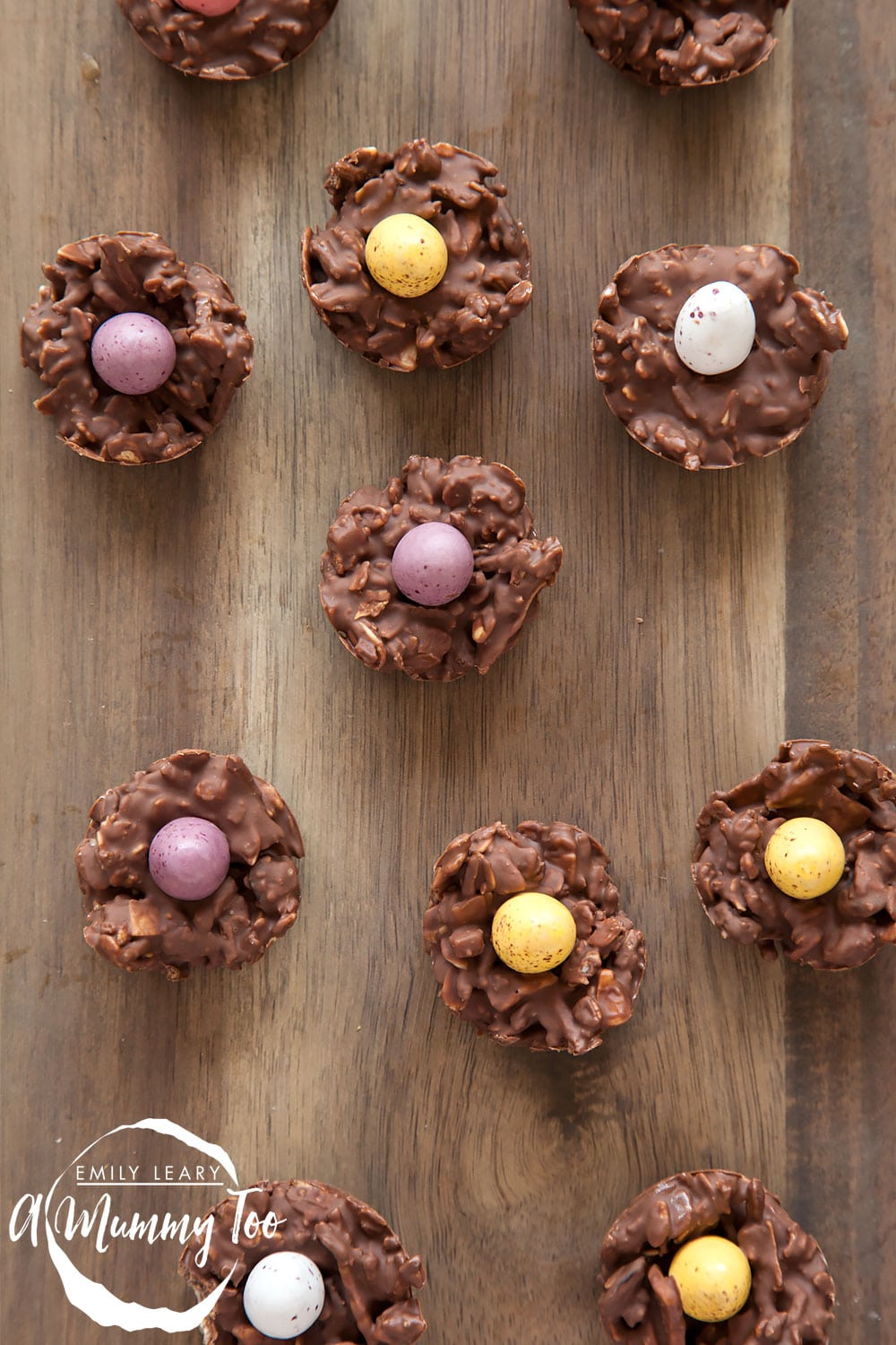 Muesli chocolate nests, topped with mini eggs - the finished product from my Easter chocolate muesli nest recipe at A Mummy Too