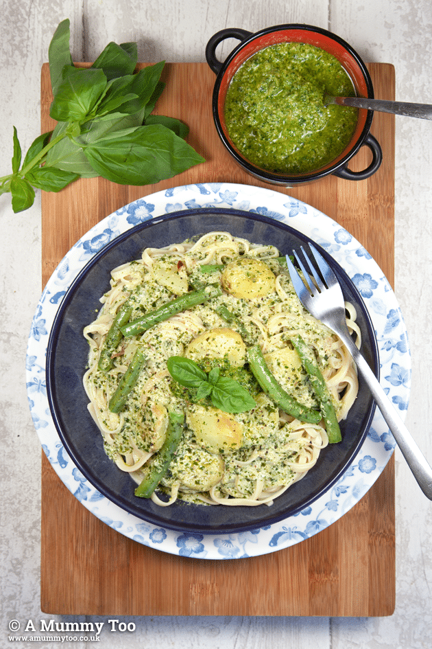 Linguine alla genovese. Al dente linguine, new potatoes and green beans in a creamy fresh basil pesto sauce.