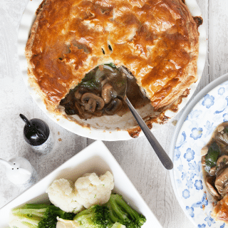 Spinach and mushroom puff pie with thyme, white wine and black truffle oil