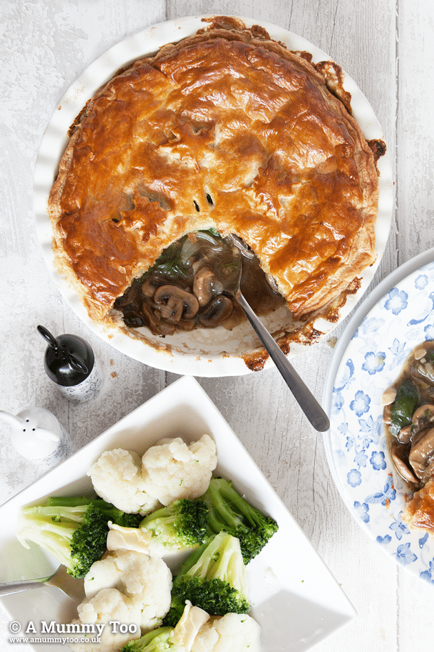 Spinach and mushroom pie with garlic, thyme and white wine sauce - shown served with mixed vegetables