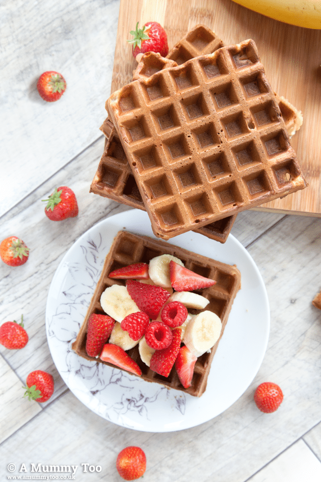 Wholemeal fruity waffles, topped with strawberries and bananas