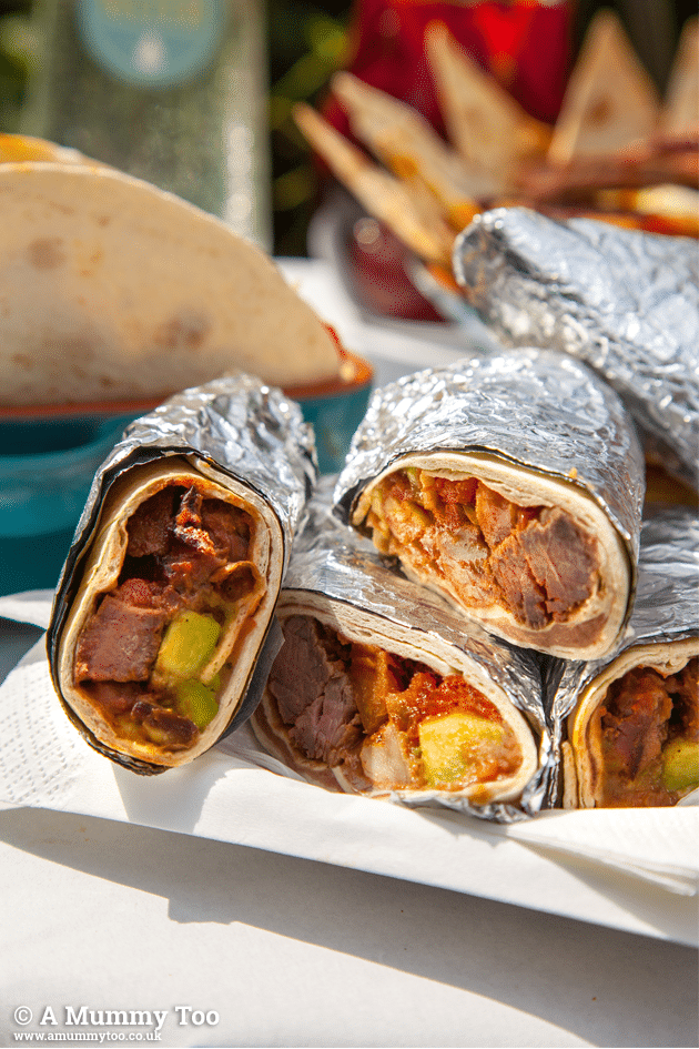Lamb carne asada burritos ready to serve at a Mexican BBQ