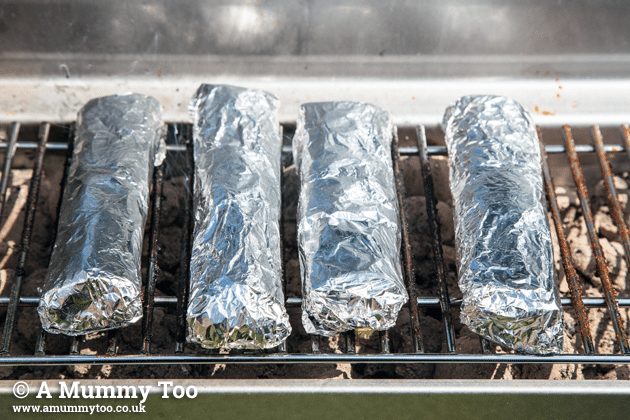 Lamb carne asada burritos on a BBQ grill