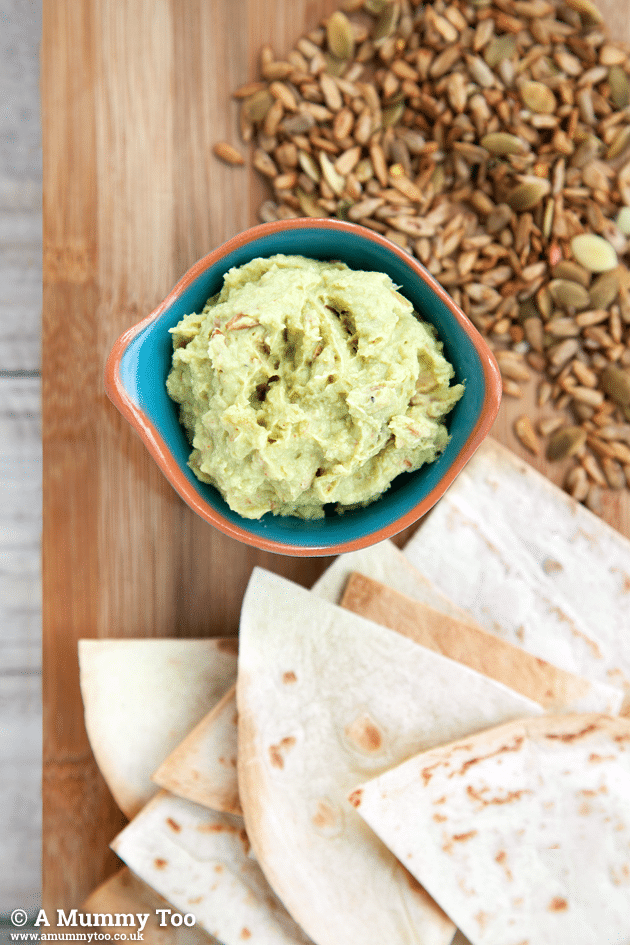 Seeded chilli avocado houmous (no tahini, vegan, raw) served with warmed tortillas