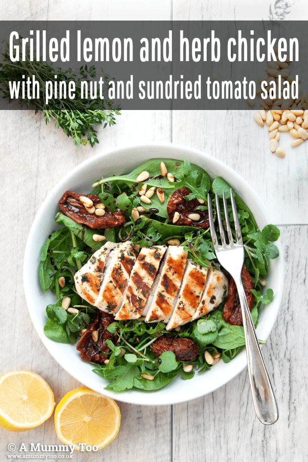 This grilled lemon chicken salad is topped with pine nuts and sundried tomato